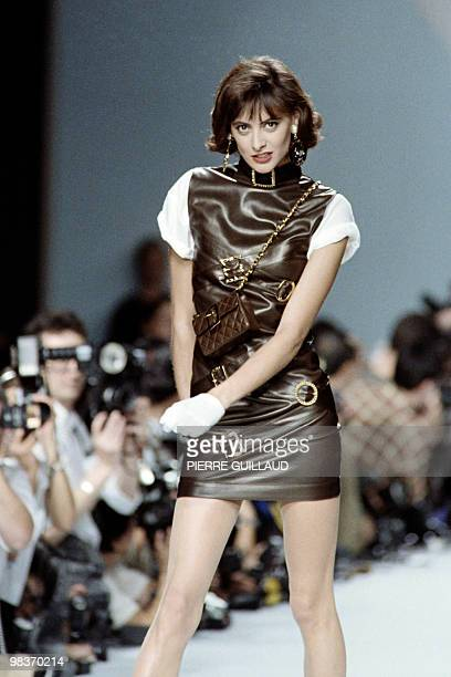 French model Ines de la Fressange presents a creation by fashion designer Karl Lagerfeld for Chanel SpringSummer 1988 readytowear collection in Paris...