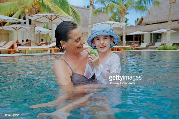 French model Ines de La Fressange who is currently pregnant and her daughter Nine on vacation in Mauritius