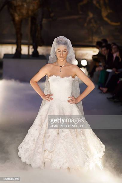 France givenchy wedding dress stock photos and pictures getty images french model marie de villepin displays 08 july 2004 a creation by french designer franck sorbier junglespirit Choice Image