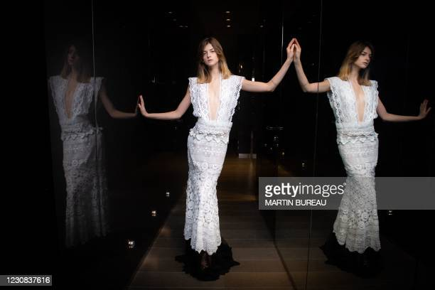 French model Mathilde Charuet wearing a creation of Italian designer Sofia Crociani poses to present Aelis' Spring-Summer 2021 collection for the...