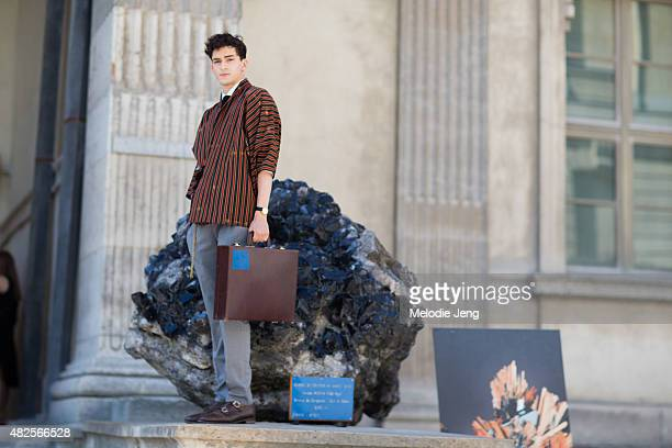 French model Ryan Hassaine at Museum National d'Histoire Naturelle Day 2 of Paris Fashion Week SS16 Mens on June 25 2015 in Paris France