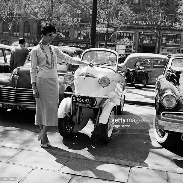French model Suzette Clairy demonstrates the advantages of the Reyonnah a narrow runabout vehicle named after its inventor Monsieur Hannoyer The...