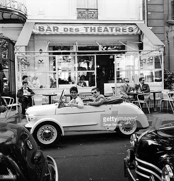 French model Suzette Clairy takes her boyfriend for a spin in a Reyonnah a narrow runabout vehicle named after its inventor Monsieur Hannoyer The...