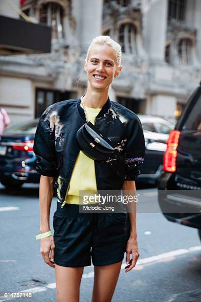 French model/actress Aymeline Valade attends the Sies Marjan show in a black bomber jacket black shorts yellow top and a black Chloe Georgia shoulder...