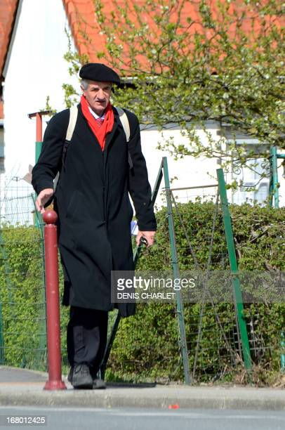French MoDem party member of parliament Jean Lassalle walks on May 4 2013 in a street of LoonPlage northern France as part of his protest march...
