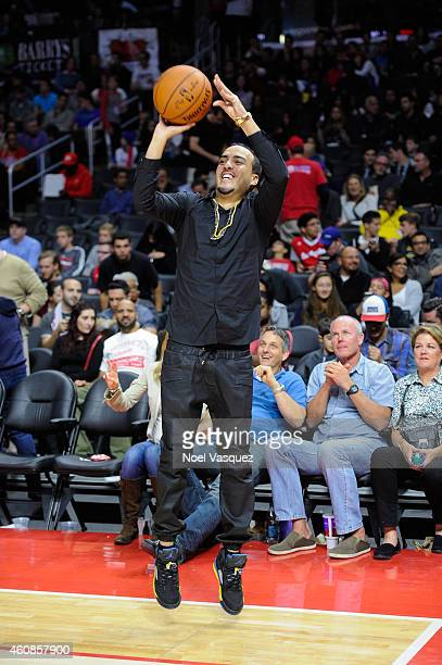 French Montana shoots a basketball at a basketball game between the Toronto Raptors and the Los Angeles Clippers at Staples Center on December 27...