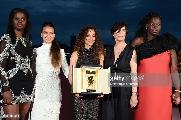 French Moroccan director Houda Benyamina poses with the Camera d'Or next to actresses Jisca Kalvanda Oulaya Amamra and Deborah Lukumuena at the Palme...