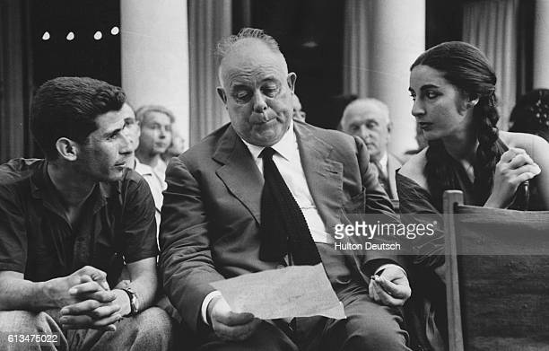French motion picture director Jean Renoir at the Venice Film Festival with aspiring young actors and actresses
