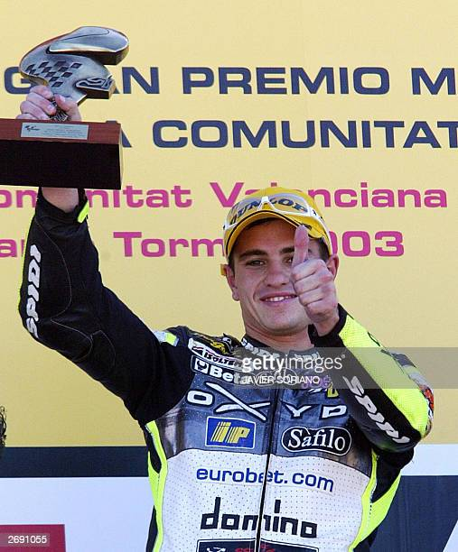 French Moto 250cc rider Randy de Puniet celebrates with his trophy on podium after wining the Moto Grand Prix of Comunidad Valenciana in Moto 250cc...