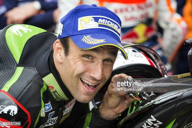 French MotoGP rider Johann Zarco of the Monster Yamaha Tech 3 team poses with a scale figure of his Yamaha motorbike after qualifications for the...