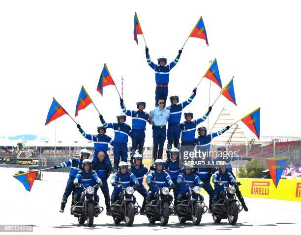 French motorcycle gendarmes perform at the Circuit Paul Ricard in Le Castellet southern France on June 21 a few days ahead of the Formula One Grand...