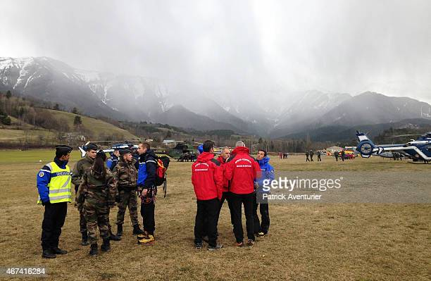 French mountain rescue teams and gendarmerie arrive near the site of the Germanwings plane crash near the French Alps on March 24 2015 in La Seyne...