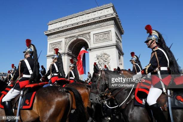 French Mounted Republican guards march during the traditional military parade as part of the Bastille Day military parade on the Champs Elysees...