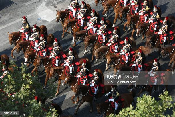 French Mounted Republican guards take part in the annual Bastille Day military parade on the ChampsElysees avenue as the Arch of Triumph in Paris on...