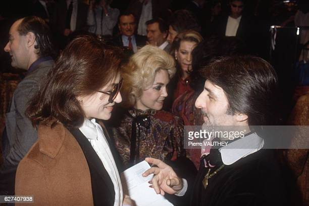 French movie actress Anouk Aimee talks with French fashion designer Emmanuel Ungaro at his SpringSummer 1983 fashion show in Paris Ungaro presented...
