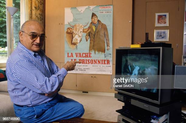 French Movie Director Henri Verneuil With Poster Of His Movie La Vache Et Le Prisonnier Now Colorized June 14 1990