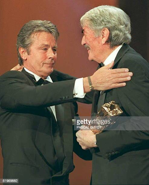 French movie star Alain Delon congratulates US actor Gregory Peck after he was awarded an honorary Cesar award for life achievement late 25 February...
