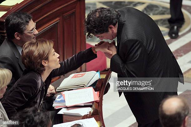 French MP Christian Jacob president of the sustainable development committee at the national Assembly kisses the hand of France�s Junior Ecology...