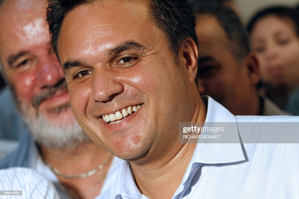 French MP Didier Robert, the candidate of right-wing UMP ruling party in the French Indian island of La Reunion, celebrates after he announced his victory on March 21, 2010 in Le Tampon, a southern town of the island, for the second round of the French regional elections. Robert faced the president of La Reunion regional council, communist Paul Verges, 85, head of the left-wing parties.