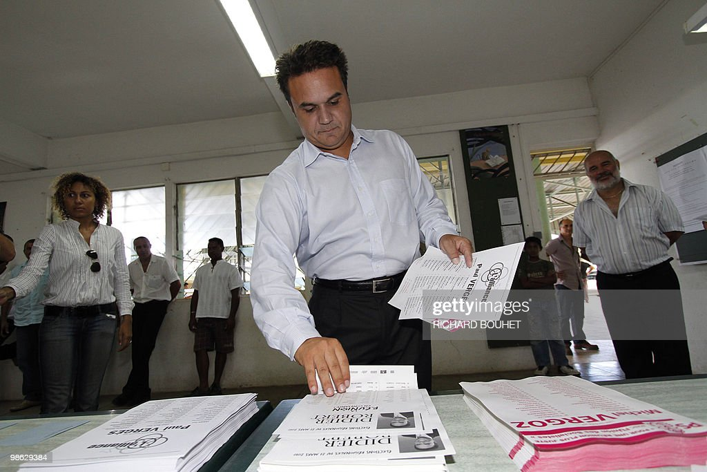 French MP Didier Robert, the candidate of right-wing UMP ruling party in the French Indian island of La Reunion, prepares to vote at a polling station on March 21, 2010 in Le Tampon, a southern town of the island, during the second round of the French regional elections. Robert faces the president of La Reunion regional council, communist Paul Verges, 85, head of the left-wing parties French voters came out today expected to deal French President a stinging rebuke in regional elections that will be his last big national test before seeking re-election in 2012.