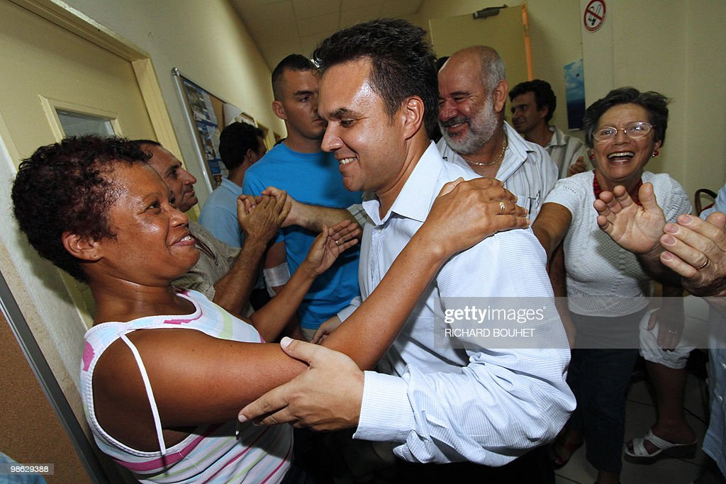 French MP Didier Robert, the candidate of right-wing UMP ruling party in the French Indian island of La Reunion, is congratulated after he announced his victory on March 21, 2010 in Le Tampon, a southern town of the island, for the second round of the French regional elections. Robert faced the president of La Reunion regional council, communist Paul Verges, 85, head of the left-wing parties.