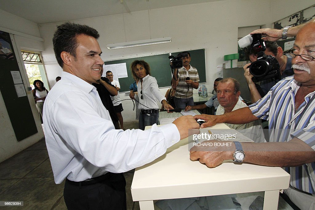 French MP Didier Robert, the candidate of right-wing UMP ruling party in the French Indian island of La Reunion, casts his ballot at a polling station on March 21, 2010 in Le Tampon, a southern town of the island, during the second round of the French regional elections. Robert faces the president of La Reunion regional council, communist Paul Verges, 85, head of the left-wing parties French voters came out today expected to deal French President a stinging rebuke in regional elections that will be his last big national test before seeking re-election in 2012.