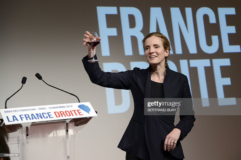French MP of the Union for a Popular Movement right-wing opposition party (UMP) and former Minister, Nathalie Kosciusko-Morizet toasts with a glass of wine after delivering a speech during the laun...