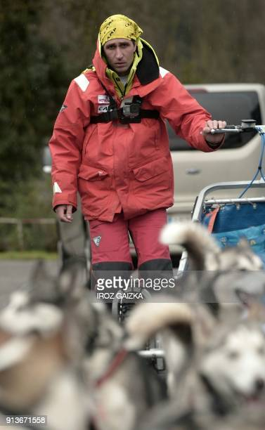 French musher Romain Da Fonseca and his dogs leave the city of Hendaye on February 3 2018 in an attempt to cross the Pyrenees mountains and reach the...