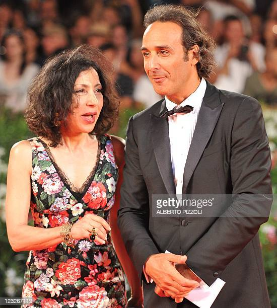 """French music composer Alexandre Desplat and guest arrivs for the screening of """"Carnage"""" at the 68th Venice Film Festival on September 1, 2011at..."""