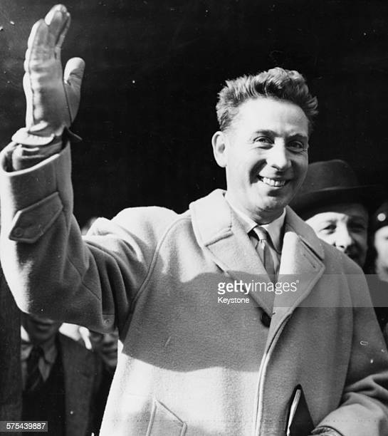 French musician Charles Trenet waving as he arrives in the country to perform at the Saville Theatre at Victoria Station in London November 11th 1950