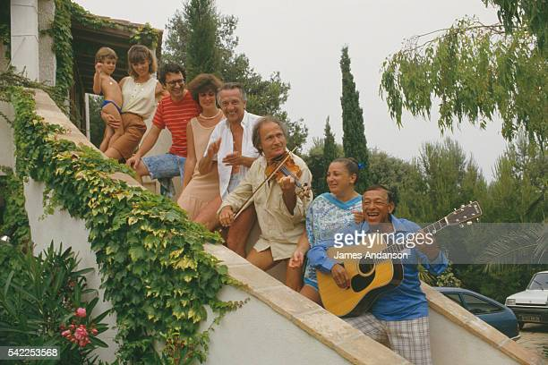 French musician composer and singer Henri Salvador playing guitar his wife Sabine Israeli violinist Ivry Gitlis French actor Jean Pierre Cassel and...