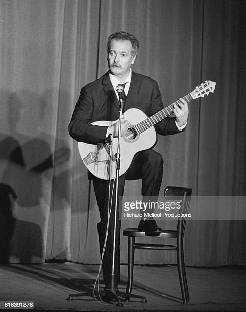French musician Georges Brassens performing during his premier at the Bobino Theater in Paris