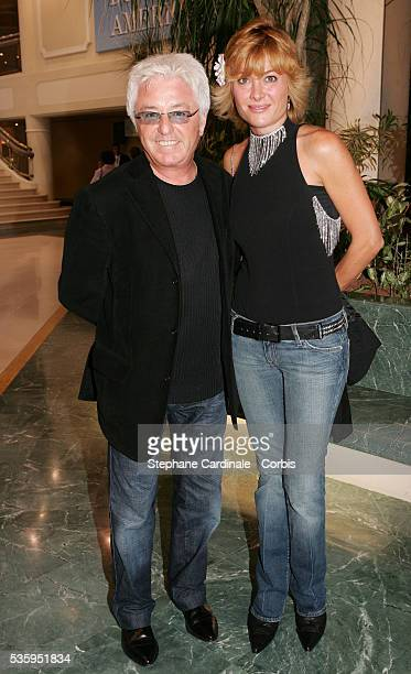 French musician JeanMarc Cerrone and his wife arrive at the premiere of director Claude Lelouch's movie 'Le Genre humain 1 Les Parisiens' selected...
