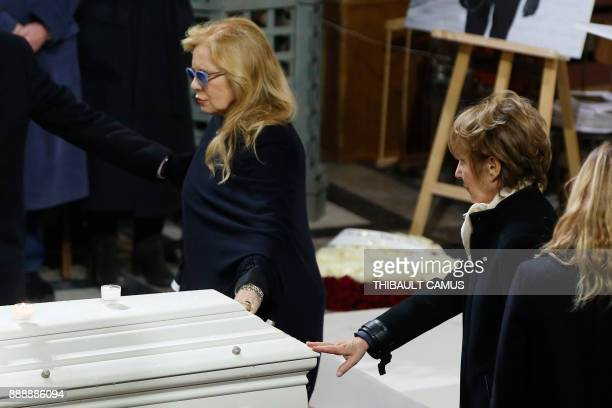 French musician Johnny Hallyday's former wives singer Sylvie Vartan and actress Nathalie Baye pay their last respects to French rocker Johnny...