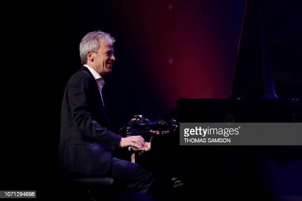 French musician Laurent de Wilde plays piano after receiving the Jazz award during the SACEM Grand Prix awards ceremony on December 10 2018 at the...