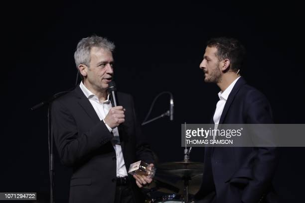 French musician Laurent de Wilde talks next to French humorist Vincent Dedienne after receiving the Jazz award during the SACEM Grand Prix awards...