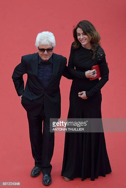 French musician Marc Cerrone and his wife Jill arrive on May 13 2016 for the screening of the film Ma Loute at the 69th Cannes Film Festival in...