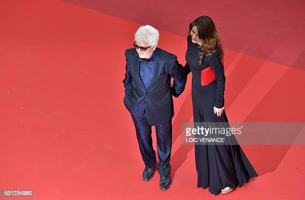 French musician Marc Cerrone and his wife Jill pose on May 13 2016 as they arrive for the screening of the film Ma Loute at the 69th Cannes Film...