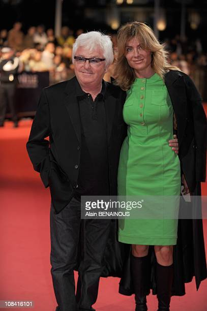 French musician Marc Cerrone poses with his wife Jill upon arrival for the screening of 'Hellboy II The Golden Army' starring US actor Ron Perlman US...