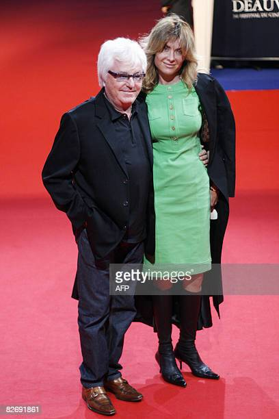 French musician Marc Cerrone poses with his wife Jill upon arrival for the screening of Hellboy II The Golden Army starring US actor Ron Perlman US...