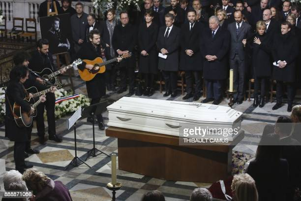 TOPSHOT French musician Matthieu Chedid plays guitar next to the coffin during the funeral ceremony of late French singer Johnny Hallyday next to...