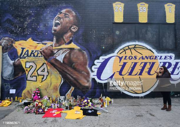 French national and longtime US resident Natalie Burle blows a kiss in direction of Kobe Bryant mural in downtown Los Angeles on January 27 2020 Nine...