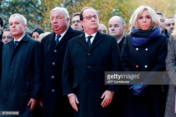 French National Assembly speaker Francois de Rugy French Senate speaker Gerard Larcher former French President Francois Hollande and Brigitte Macron...