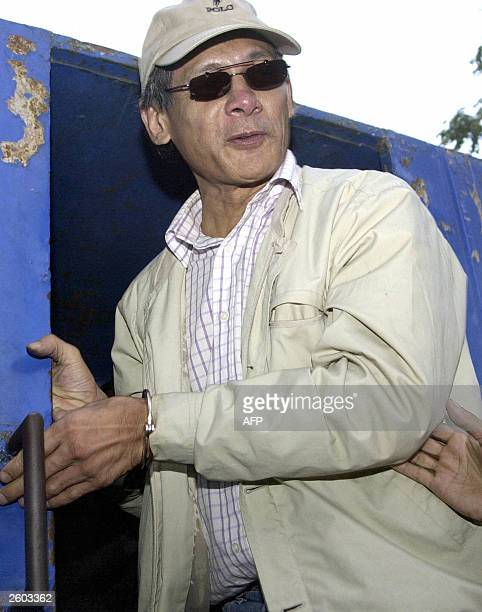 French national Charles Sobhraj emerges from a Nepalese police truck after being released on bail following a fake passport case in Kathmandu ,16...