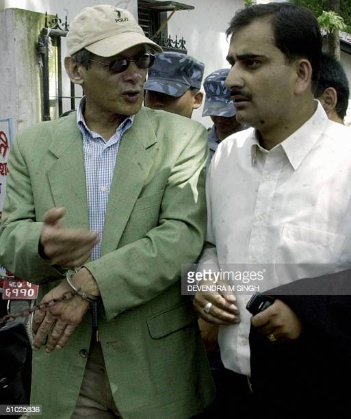 French national Charles Sobhraj talks with his lawyer Sanjeev K Ghimire as he arrives for a hearing at a District Court in Kathmandu, 05 July 2004....