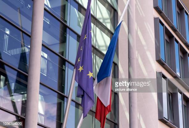 A French national flag and a European Unionflag flying at halfmast above the entrance to the French consulate general in MunichGermany 15 July...
