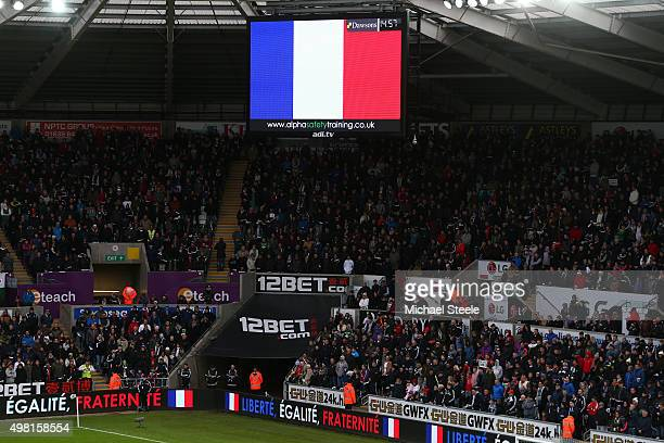 French national flag is displayed to remember the victims of the terror attacks in Paris last week prior to the Barclays Premier League match between...