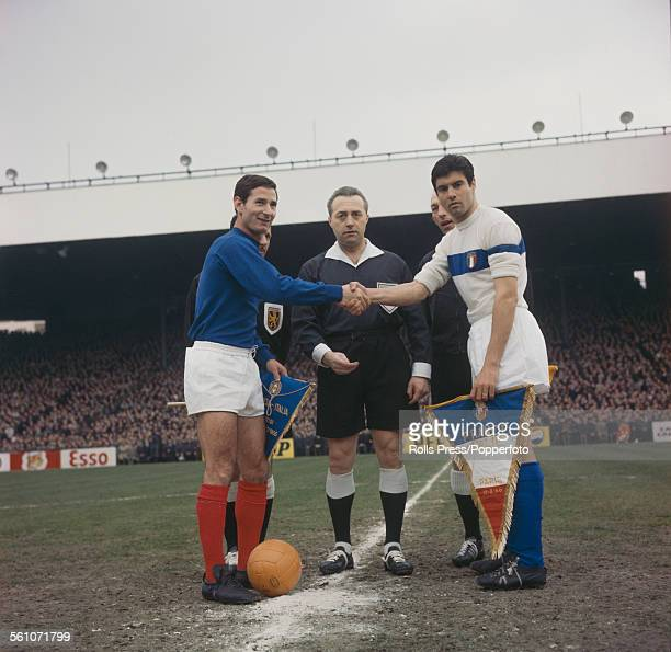 French national football team captain Marcel Artelesa shakes hands and exchanges penants with Italian national football team captain Sandro Salvadore...