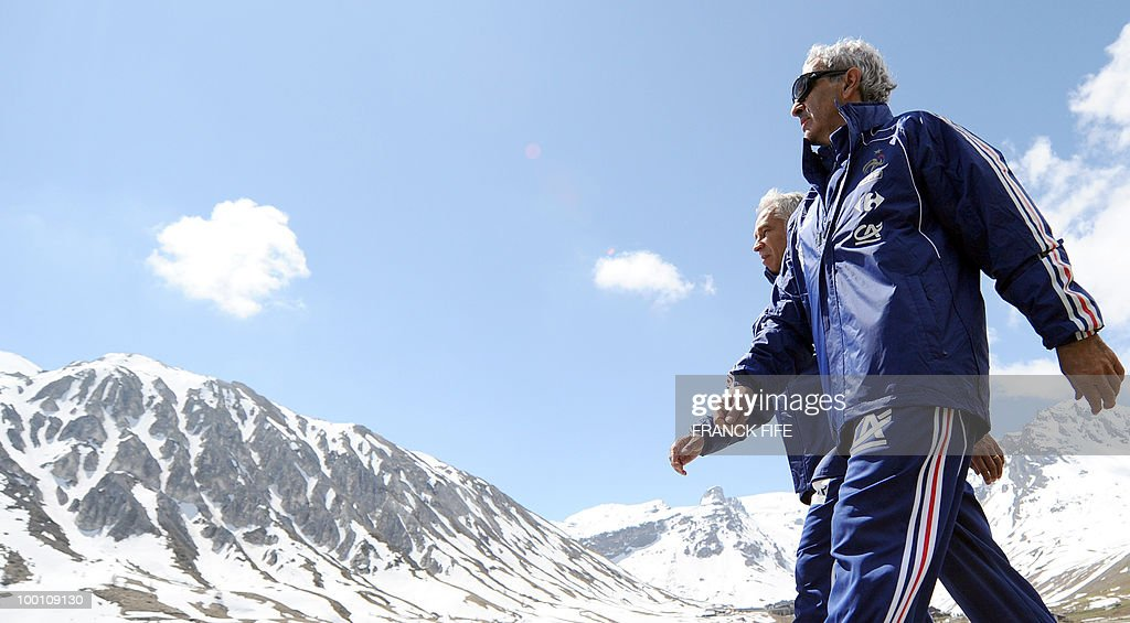 French national football team coach Raymond Domenech (R) and assistant coach Pierre Mankowski walk during a training session on May 21, 2010 in Tignes' lake, French Alps, as part of their preparation for the upcoming World Cup 2010 in South Africa. France will play Uruguay in Capetown in its group A opener match next June 11.