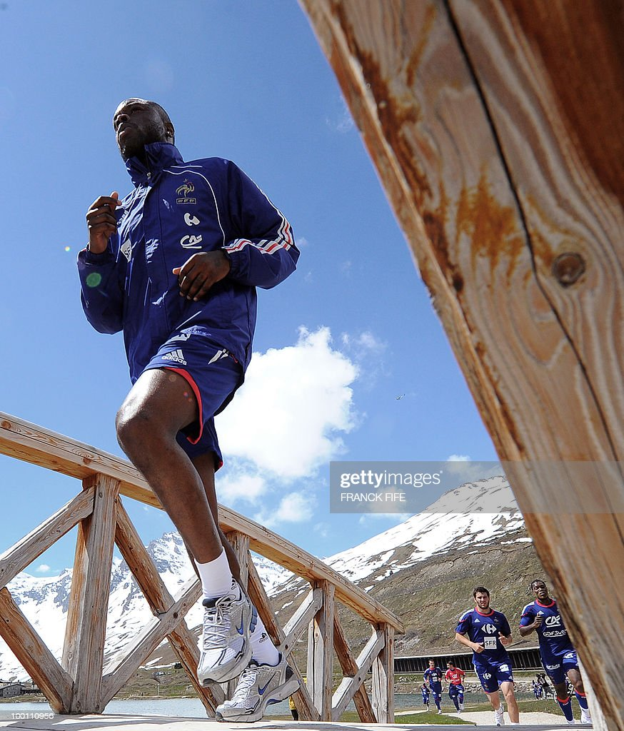 French national football team defender William Gallas and team mates jog during a training session on May 21, 2010 around Tignes' lake, in the French Alps, as part of their preparation for the upcoming World Cup 2010 in South Africa. France will play Uruguay in Capetown in its group A opener match next June 11.